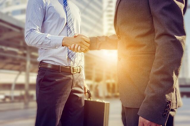 sellers shaking hands