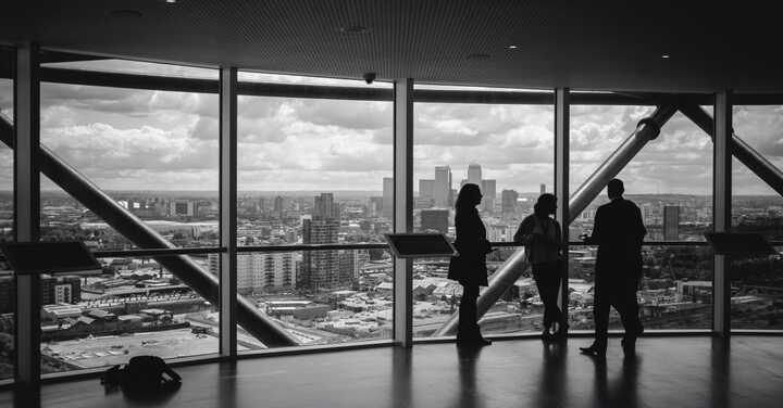 Business-people-standing-by-window_BW